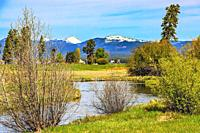 Wood River, southern Oregon. Snow capped mountains of the Cascade Range in the distance.