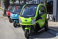 Denver, Colorado - Three-wheel electric cars manufactured by Echo3 Energy. The three-passenger Echo3 has a range of 55 miles and top speed of 35 mph. ...