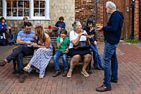 People Eating Food In The Street, Lewes, East Sussex, UK.