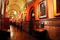 A portrait of Teddy Roosevelt hangs in a long hallway of the New York State House in Albany, New York.