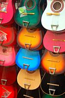 Mini guitars are displayed at a kiosk in El Pueblo, a historic Hispanic market in Los Angeles.