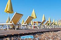 BECICI ANDi BUDVA, BUDVA MUNICIPALITY, MONTENEGRO - JULY 31, 2020: During the COVID-19 pandemic, used medical face masks pollute European beaches, the...