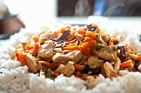 chicken in Chinese with vegetables with rice.