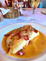 Hake loin with onion and pepper. Spain.