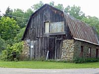 Old Stone and Wooden Barn, Allegany County, New York, USA.