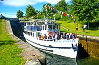 "The old passenger boat """"Kung Sverker"""" in a lock on the Gota Canal at Borenshult, Ostergotland, Sweden, Scandinavia. The Gota Canal was constructed i..."