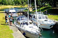 Leisure boats in a lock in Gota Canal at Motala, Ostergotland, Sweden. The Gota Canal was constructed in the 19th century. It links various rivers and...