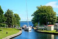 Leisure boats leave the locks in Gota Canal at Borenshult, Motala, Östergötland, Sweden. The Gota Canal was constructed in the 19th century. It links ...