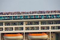 Venice (Italy). Staterooms and tourists on an ocean liner next to the city of Venice.