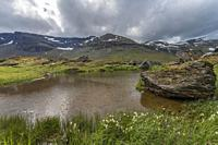 Hiking trail at Kärkevagge, Swedish Lapland with mountains in background and cloudy weather, Kiruna county, Swedish Lapland, Sweden.