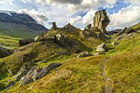 Hiking trail at Kärkevagge, Swedish Lapland with big rocks and mountains in background and cloudy weather, Kiruna county, Swedish Lapland, Sweden.