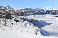 Snowy landscape in spring time with mountains in background, Stora sjöfallets nationalpark, Laponia world heritage, Swedish Lapland, Sweden.