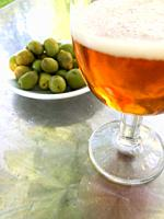 Glass of beer and green olives. Spain.