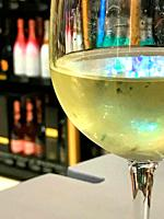 Glass of white wine. Close view.
