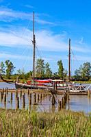 Wooden hulled sailing ketch tied up at the Britannia Ship Yard in Steveston British Columbia Canada.