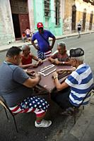 Local people playing domino at the street in Old Havana district, Havana, La Habana, Cuba, West Indies, Central America