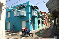 Motorcyclist at the historic center, Cartagena de Indias, Bolivar, Colombia, South America.