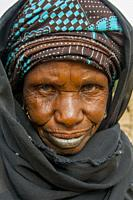 Portrait of a local woman standing on the bank of the Niger River in Segou, a city in the center of Mali, West Africa.