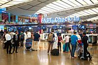 Singapore, Republic of Singapore, Asia - Air travellers at the fast check-in area with electronic self check-in kiosks at Changi Airport Terminal 2, o...