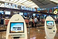 Singapore, Republic of Singapore, Asia - Fast check-in area with electronic self check-in kiosks at Changi Airport Terminal 2, only a few weeks prior ...
