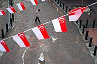 Singapore, Republic of Singapore, Asia - Elevated view of little flags in the national colours of the city-state that waver as pennant banners above a...