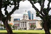 Singapore, Republic of Singapore, Asia - View across the Padang playing field towards the National Gallery Singapore, formerly the Supreme Court and C...