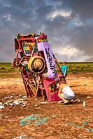 Cadillac Ranch with its highly painted vehicles in the middle of a muddy field just outside Amarillo, Texas.