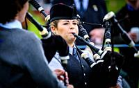 A lady piper playing at a 'Highland Games' in the Scottish Borders.
