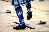 A young girl performing the sword dance at a highland games in Scotland.