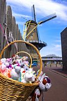 Cuddly Toys for sale in front of a windmill in Hellevoetsluis, The Netherlands, Europe.
