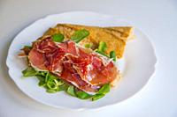 Iberian ham with water cress and olive oil on sliced bread. Spain.