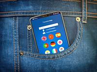 Mobile phone with language translator or mobile dictionary application in jeans pocket. Learning languages online. concept. 3d illustration.