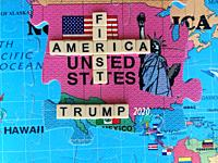 America First, the favourite slogan of President Trump, on a map of the world showing the United States. Conceptual image with letter tiles and puzzle...