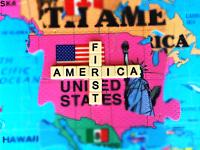 Conceptual image. America First, in words and icons. Jigsaw pieces with a US map rise above the rest of the world in a puzzle map.