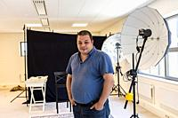 Eindhoven, Netherlands. Portrait of Photographer Bram van Dal inside his new portrait studio.
