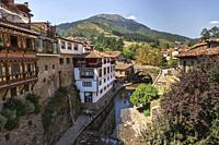 Views of the medieval town of Potes with hanging houses and the Deva river, Cantabria, Spain.