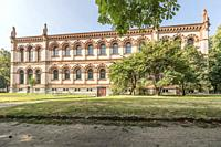 northern facade of Natural Science Museum historical building at urban park, shot in bright summer light at Milan, Lombardy, Italy.