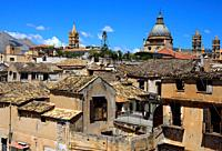 In foreground architecture of old town of Palermo, In background towers and Cupola of Roman Catholic Archdiocese of Palermo, Cathedral dedicated to th...