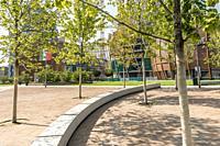 MILAN, ITALY - August 20 2020: cityscape with young trees on paved ground at business hub urban renewal development, shot on august 20 2020 at Milan, ...