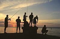 Fishermen at sunset by the Malecón in Havana,Cuba.