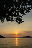view from Koh Ta Kiev island towards Koh Russei near Sihanoukville in Cambodia at sunset.