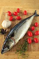 Mackerel, fish, cherry tomatoes, garlic, thymus,.