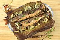 Arctic char, fish, oven baked, thai basil, onions, banana leaf, thai style dipping sauce,.