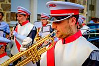 A trumper player in the town band plays during Bastille Day celebrations in the town of Villaines-la-Juhel, Pays de la Loire, France.