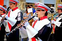 A clarinet player in the town band plays during Bastille Day celebrations in the town of Villaines-la-Juhel, Pays de la Loire, France.