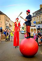 Jugglers entertain a small crowd in the town of Villaines-la-Juhel, Pays de la Loire, France during bastille Day celebrations.