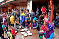 Family and friends having lunch togather for some celebration in Bei people's village in Dali, yunnan province, china