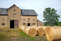 old shed at farm with hay rolls in Bourgogne, France
