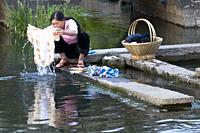 CHINA Woman washing clothes in a village in Yunnan province. Photo by Julio Etchart.