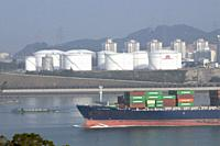 CHINA European ships half-loaded with containers, due to recession, leaving Xiamen harbour, Fujian province. Photo by Julio Etchart.